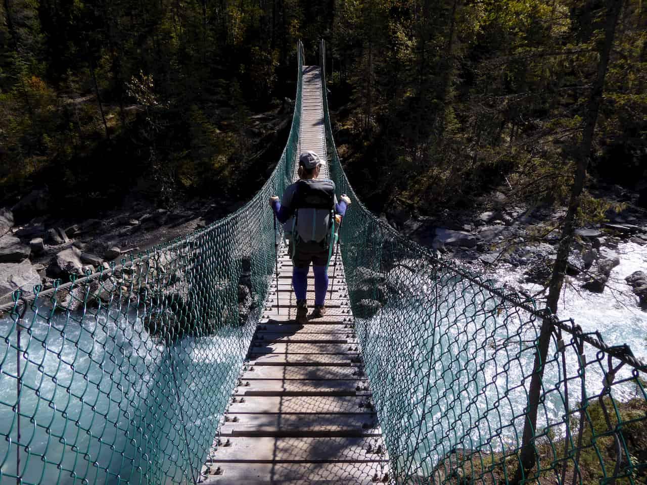 Hiking across suspension bridge to Mount Robson
